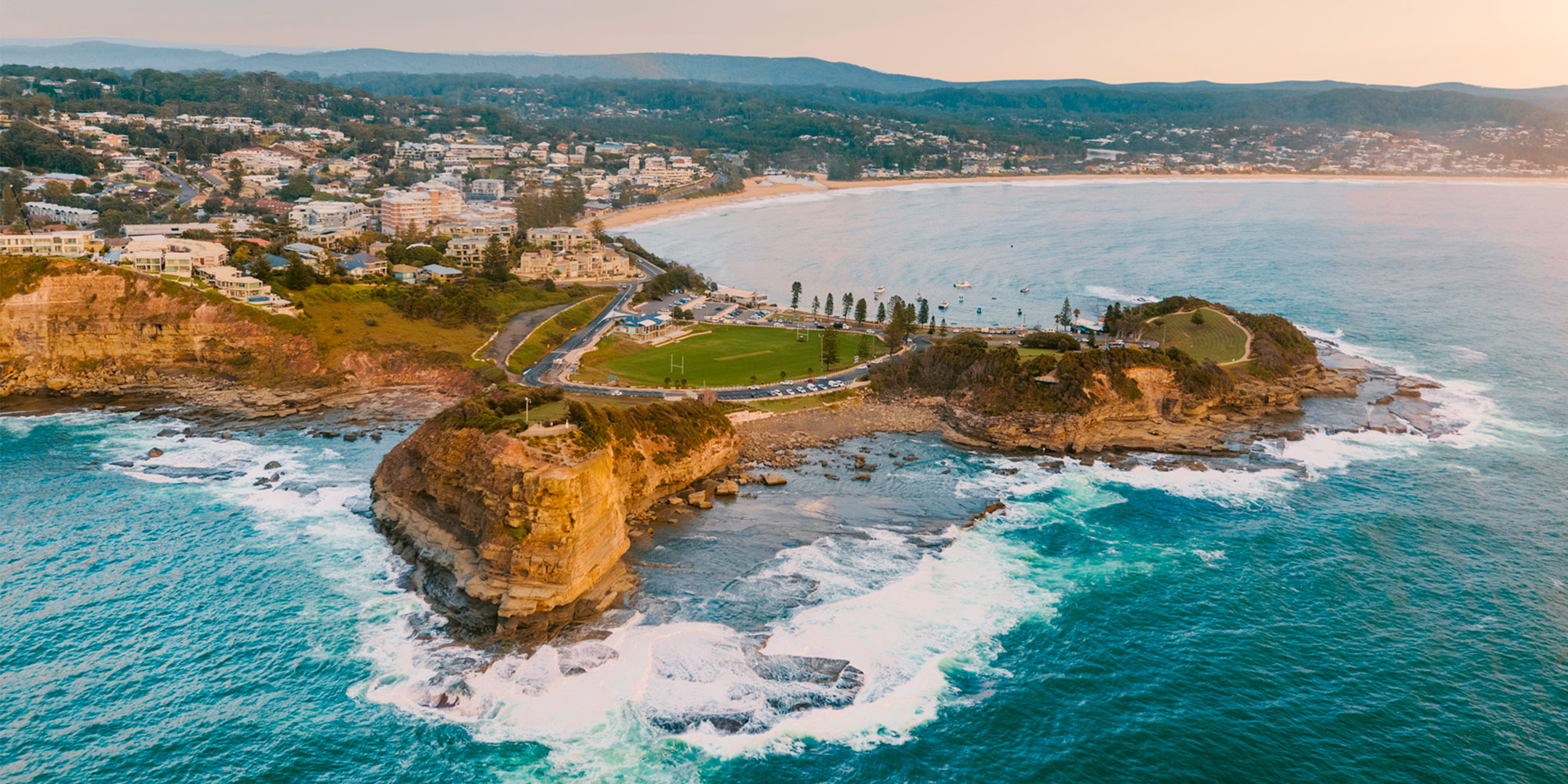 View over Terrigal showing coastline, Skillion, town and beaches