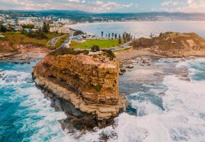 View of the cliffs and rocky bay with Terrigal town in the background