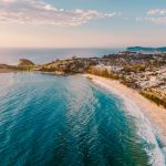 Coastal aerial shot showing pristine beaches, rolling water and Terrigal in the Central Coast